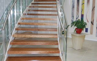 sweeping timber and glass staircase