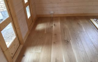 wide oak flooring room corner